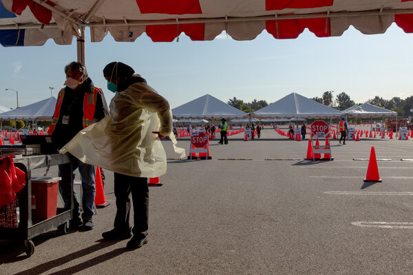 Nurses prepare to distribute Covid-19 vaccinations at The Forum vaccination super site in Los Angeles last week.