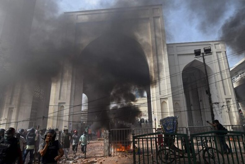 Protesters set fire to a motorcycle on Friday as they clashed with the police in Dhaka, the capital of Bangladesh.