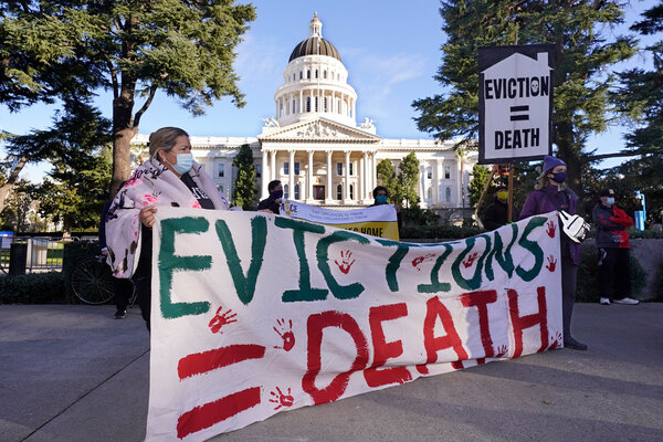 Demonstrators calling for lawmakers and Gov. Gavin Newsom of California to pass rent forgiveness and stronger eviction protections legislation gather in front of the State Capitol in Sacramento in January.