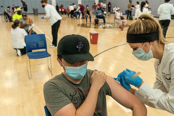 Andres Alvarez, 26, received the Johnson & Johnson Covid-19 vaccine on Monday at Booker T. Washington High School in Houston.