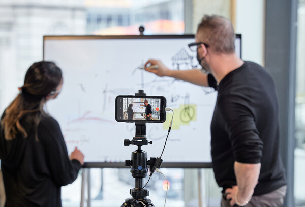 A mobile touch screen doubles as a digital whiteboard while a cellphone on a tripod makes a recording that can be used later in a presentation.