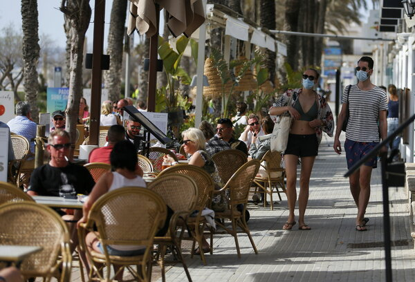 A cafe in Palma, Majorca, on Tuesday.The Spanish government has now ordered the mandatory wearing of face masks in all public outdoor spaces, including beaches.