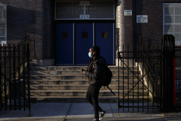 High schools have been slower to reopen than elementary schools. Students returning to a high school in Brooklyn last month when in-person classes resumed.