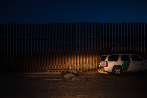 The site where the migrants drove through the border wall has since been repaired. A Border Patrol vehicle dragged tires to smooth the ground, making it easier to spot fresh footprints from migrants climbing over the wall.