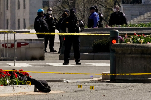 Evidence markers near the scene of the attack at the Capitol on Friday.