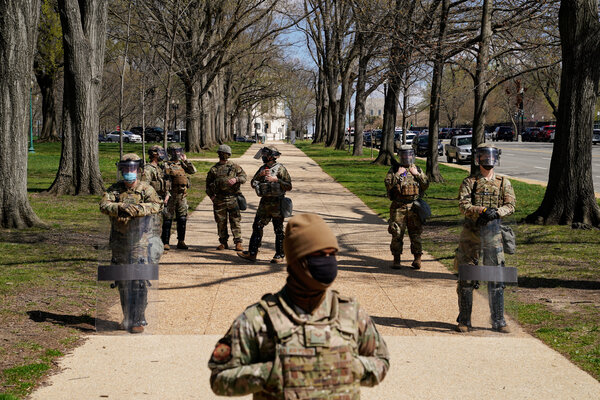 Members of the National Guard outside of the Capitol on Friday shortly after the attack.