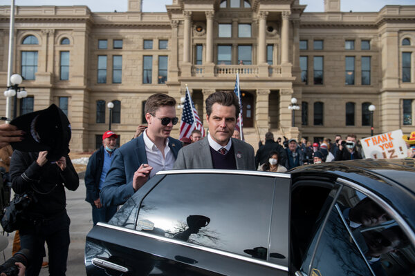 Representative Matt Gaetz leaves a rally at the Capitol building in Cheyenne, Wyo.