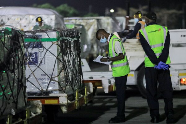 Officials at Jomo Kenyatta International Airport in Nairobi last month, logging Kenya's first delivery of Covid-19 vaccines through the global initiative known as Covax.