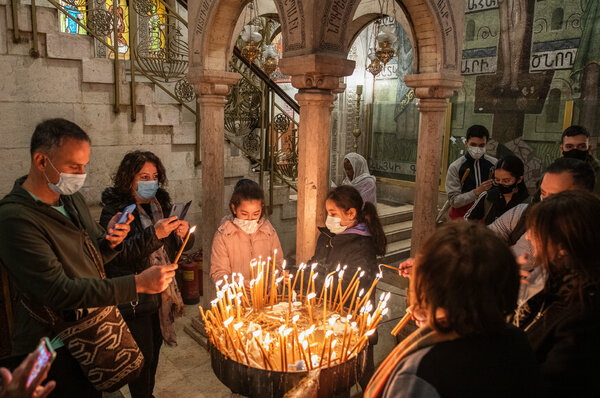 Christian worshipers at the Church of the Holy Sepulcher, during a Good Friday procession in Jerusalem.