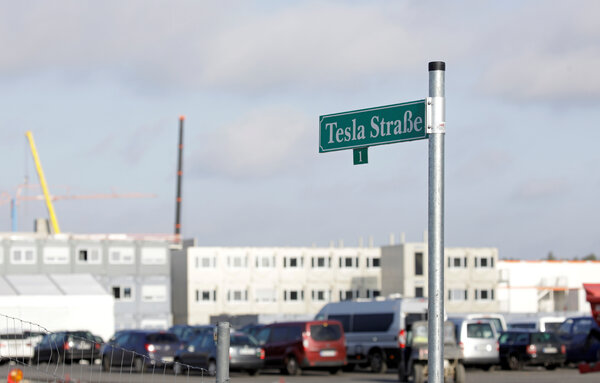 """A sign points out """"Tesla Strasse"""" or """"Tesla Street"""" outside the new factory under construction outside Berlin."""