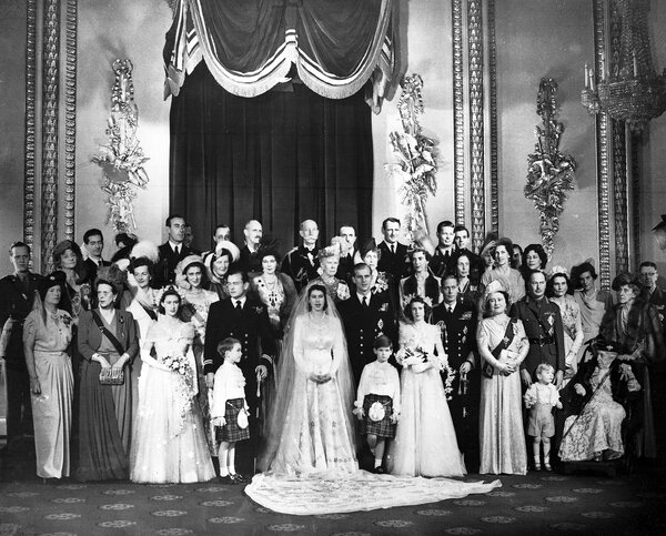 Elizabeth and Prince Philip, center, on their wedding day.