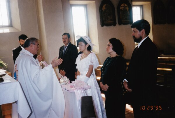 Morales celebrating her first communion in 1995.