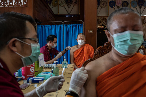 Covid-19 vaccinations at a monastery in Bangkok this month.