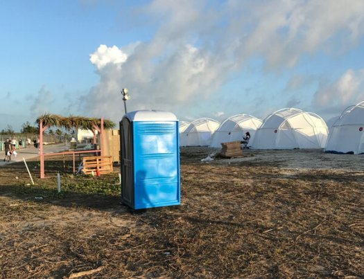 Attendees of the disastrous Fyre Festival in the Bahamas won $2 million in a class-action settlement that is subject to final approval.