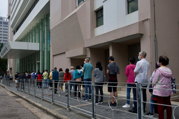"""Outside a vaccination center in Hong Kong earlier this month. Bookings have increased after the government brought in """"vaccine bubble"""" measures."""