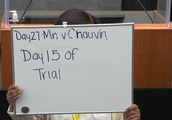 A sign marking Day 15 of the trial of the former Minneapolis police officer Derek Chauvin at the Hennepin County Courthouse in Minneapolis.