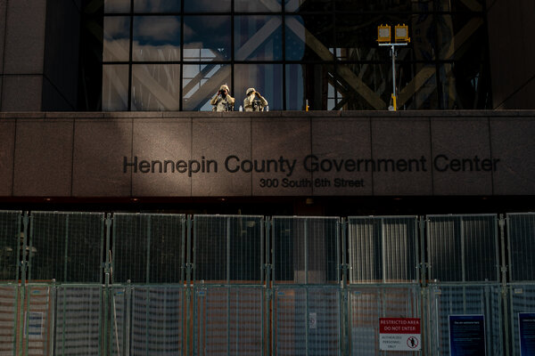 National Guard members and Minneapolis police officers standing guard outside the Hennepin County Government Center in Minneapolis on Tuesday.