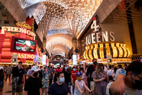 Wearing masks while walking through the Fremont Street Experience in Las Vegas earlier this month.