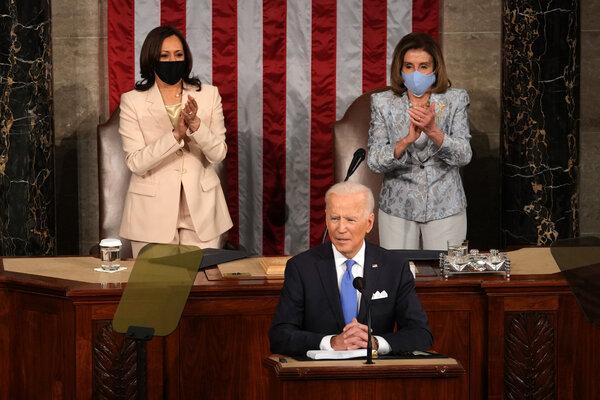 Vice President Kamala Harris, left, and Speaker Nancy Pelosi at the start of President Biden's address at the Capitol.