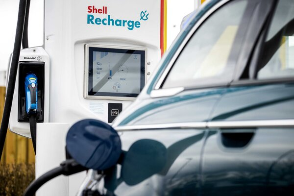 A Shell recharging station for electric vehicles in the Netherlands. Despite investments in renewable energy, Shell's profit last quarter was largely the result of rising oil and gas prices.