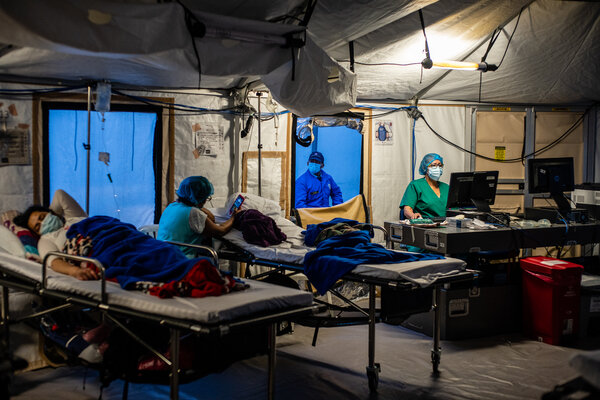 Patients in tents outside Kennedy Hospital in Bogotá, Colombia, this month. Colombia has been able to issue a first vaccine to just 6 percent of its population.
