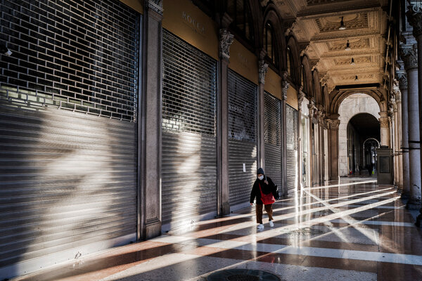 Shuttered storefronts in Milan last month. Extended lockdowns across Europe have slowed economic growth.