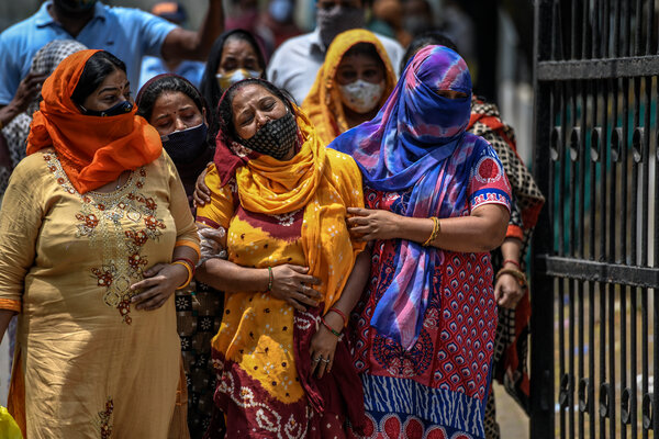 Relatives mourning outside a hospital mortuary last week in Delhi  after seeing bodies of Covid-19 victims.