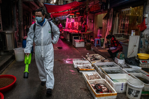 Disinfecting a wet market in Wuhan, China, in January.