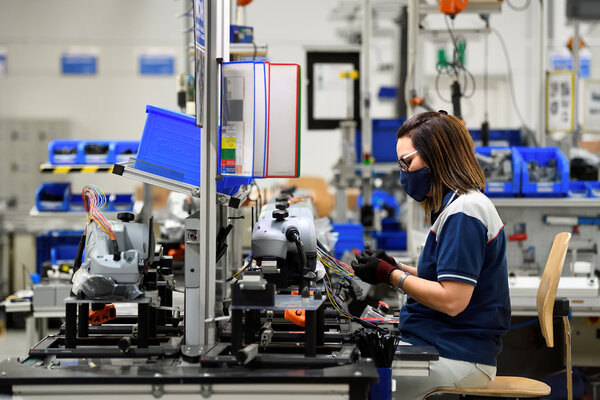 A worker at MTA, a maker of electronic components, in Codogno, Italy. Eurozone manufacturers have been reporting new orders.