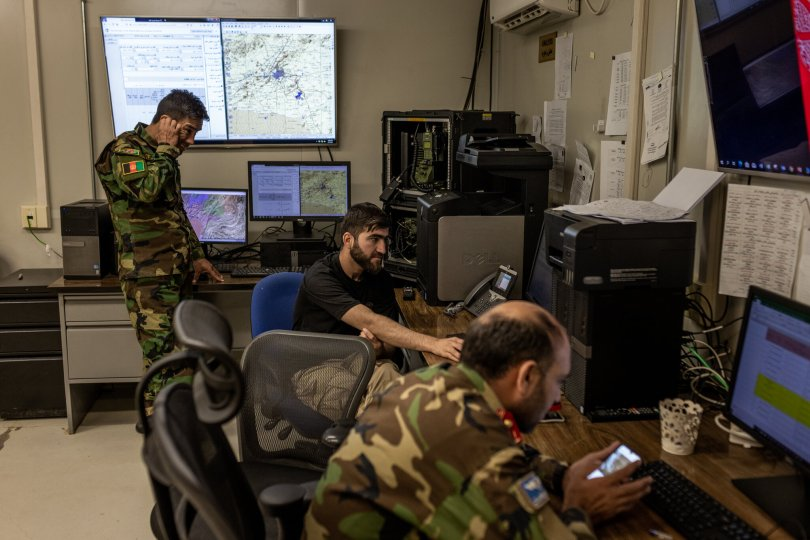 Maj. Mohammed Bashir Zahid, center, in the airfield's operations intelligence center. He said he expected that one day soon his requests for help from the Americans would be met with silence.