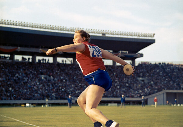 Press throwing the discus at the 1964 Summer Olympics in Tokyo. She won gold medals that year in both the discus and the shot-put.