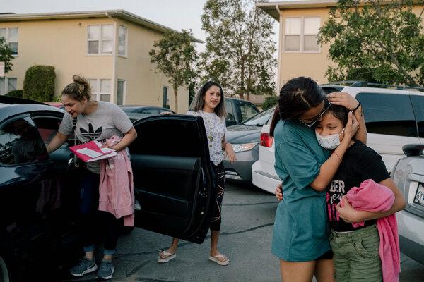 Melissa's older sister, Kimberly, hugged her when she arrived home in Oxnard, Calif.