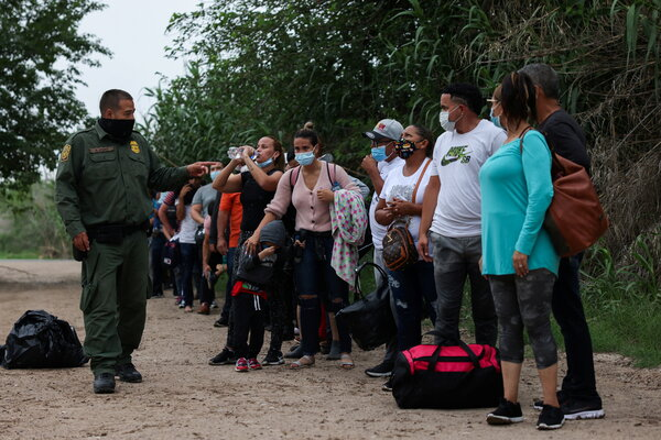 Migrants from Venezuela waiting for transportation to a U.S. Border Patrol facility on Tuesday in Del Rio, Texas, after crossing the Rio Grande.
