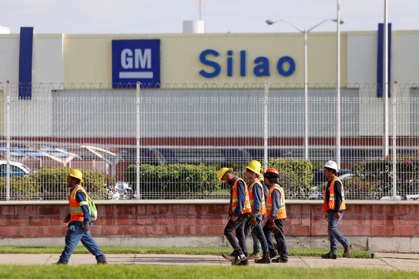 Workers leaving a General Motors plant in Silao, Mexico in 2019.
