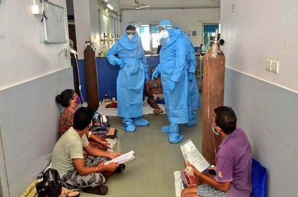 Pramod Sawant, chief minister of Goa, India, on the left and wearing personal protective gear, visited Covid-19 patients at a hospital in Panjim, a city in the state, on Tuesday.