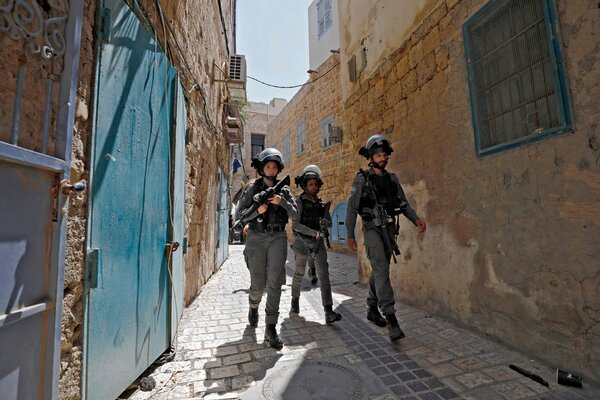 Israeli forces patrolling Acre, a mixed Arab-Jewish town in northwest Israel, on Thursday.