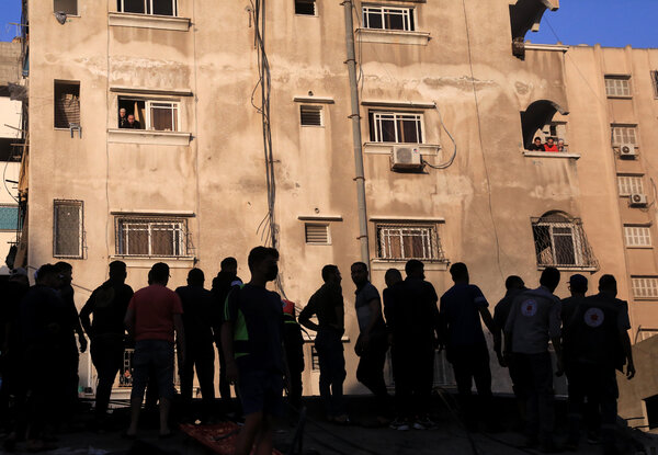 Searching for survivors on Sunday after an overnight air strike in Gaza City.