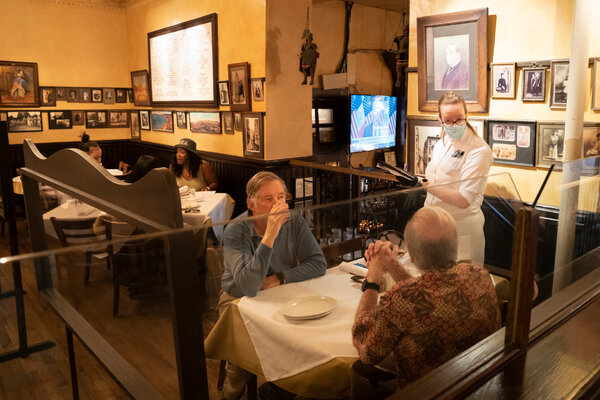 At Carmine's restaurant on the Upper West Side on Tuesday, plastic dividers were in between tables.
