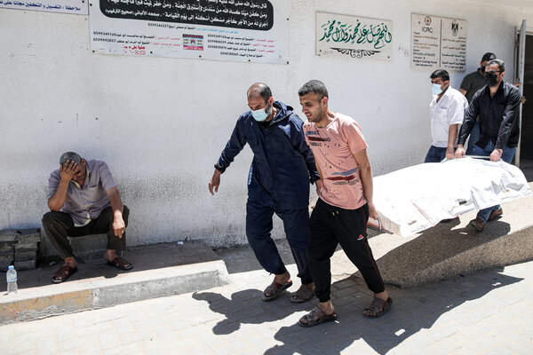 Mourners on Wednesday carried the body of Hassan Salem, who was killed during Israeli bombing of Gaza City.