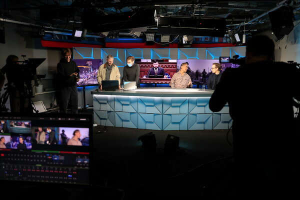 Journalists work in the studio of Radio Free Europe/Radio Liberty in Moscow, Russia in April, 2021.