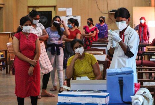 Administering Covishield, the Serum Institute version of the AstraZeneca vaccine, in Bengaluru, India.