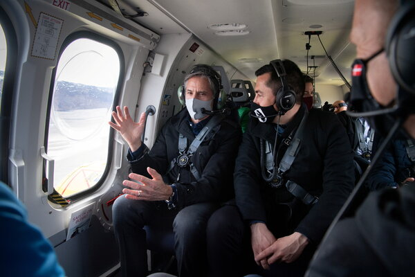 Antony Blinken, the secretary of state, left, with the premier of Greenland, Mute Egede, during an aerial tour of the territory on Thursday.