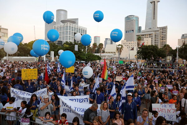 Israeli-born Filipino children with their families at a 2019 protest in Tel Aviv over the deportation of undocumented foreign workers.