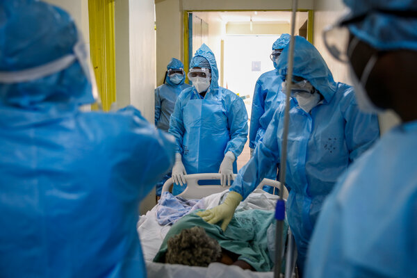 Moving a Covid-19 patient at Kenyatta National Hospital in Nairobi, Kenya, in April. Just 1.42 percent of the population of Africa has been fully vaccinated.