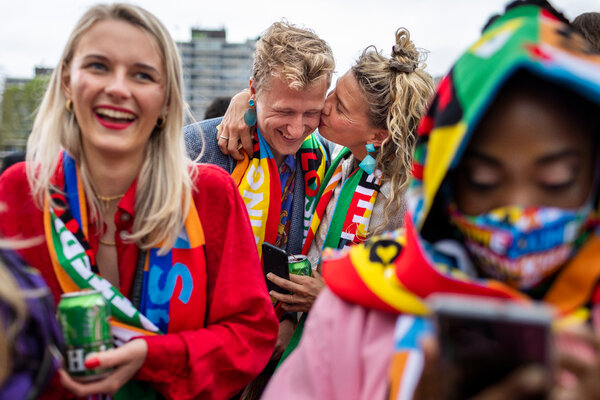 Eurovision fans waiting in the rain to enter the Ahoy Arena before the final on Saturday in Rotterdam.