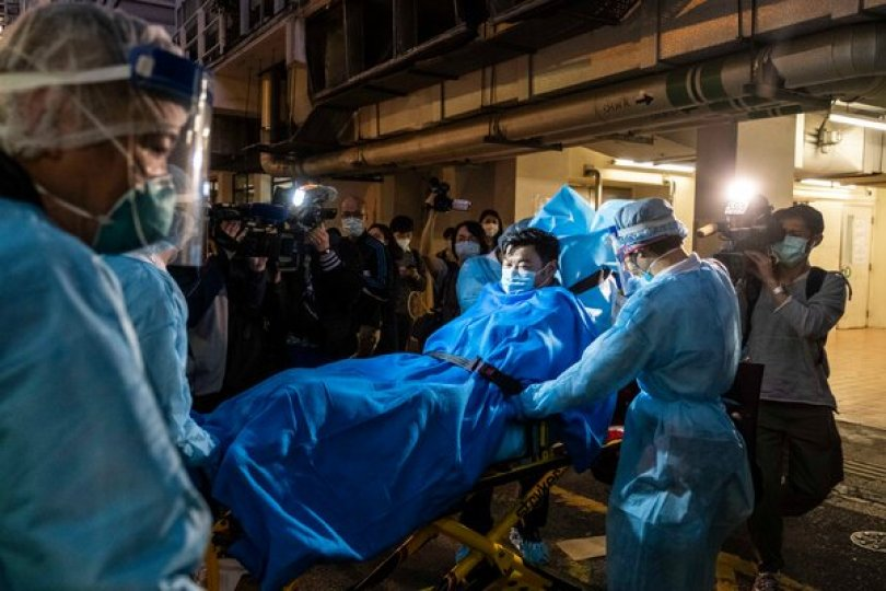 Paramedics transporting a man believed to be Hong Kong's first coronavirus patient, in January 2020.