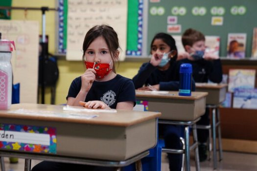 Schoolchildren swabbing and testing themselves for the coronavirus in Boston early this year.