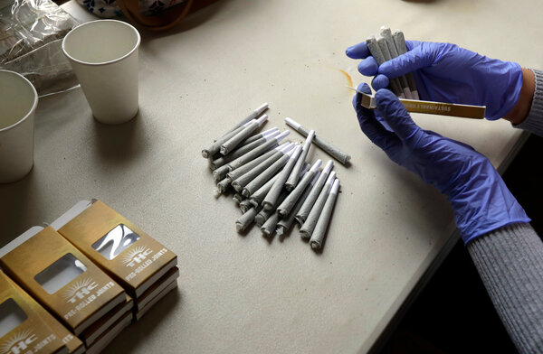 A worker at the Hollingsworth Cannabis Company packaged pre-rolled marijuana joints near Shelton, Wash., in April 2018.