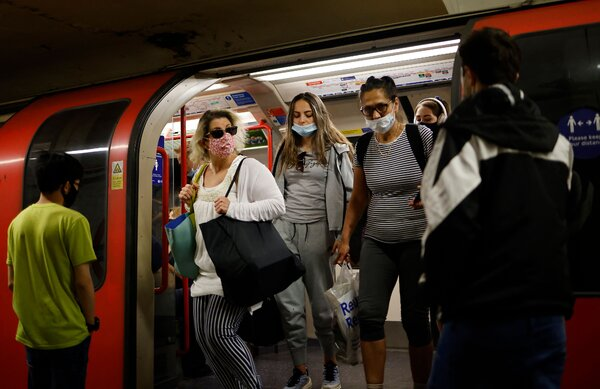 Commuters in London on Sunday. Virus cases are rising in Britain again.