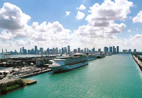 Explorer of the Seas (front), a Royal Caribbean cruise ship, along with other cruise ships in Miami, late May. It's unclear if cruise lines will be able to sail out of cities in Florida.